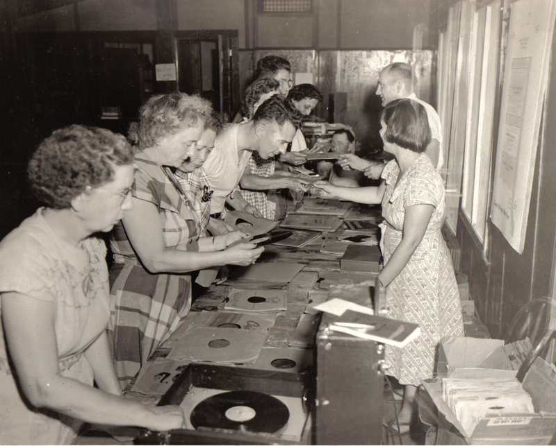 Charley Thomas selling records.jpg